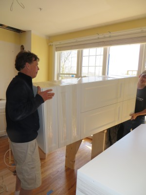 Other large cabinets making their way through the window....